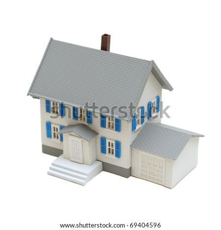 A miniature house isolated on a white background. - stock photo