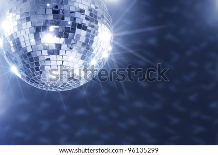 A Mirror disco ball hanging from the ceiling. - stock photo