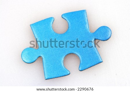 A missing piece of a jigsaw puzzle.