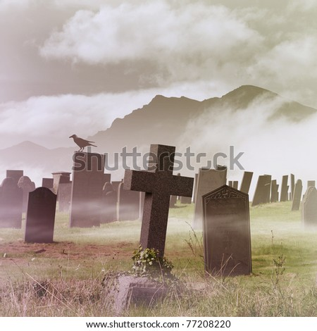 A Misty Graveyard, Cemetery with Tombstones and Crow - stock photo