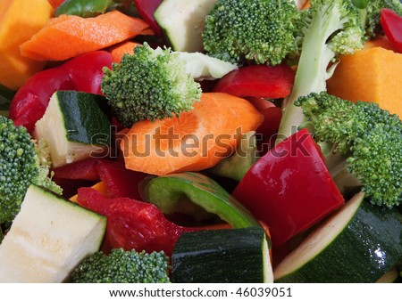 A mix of raw vegetables cut into pieces. - stock photo