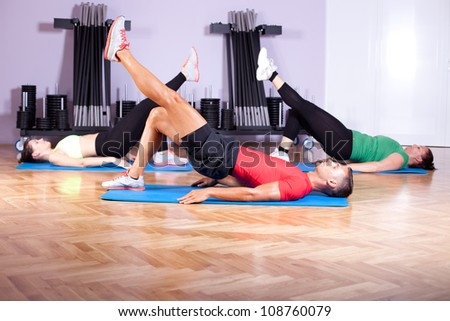 A mixed group of young people in aerobics class - stock photo