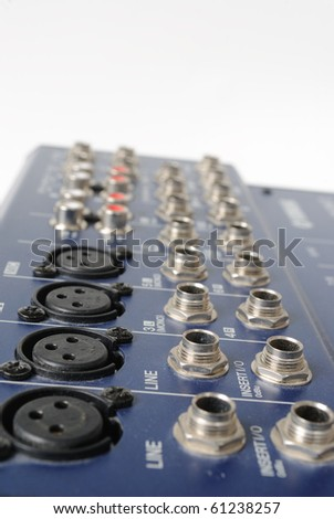A mixing board on a preamp for amplifying audio signal. - stock photo