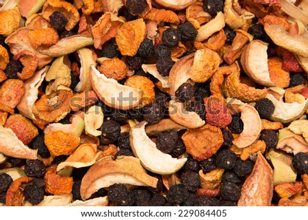 a mixture of dried fruits as a background - stock photo