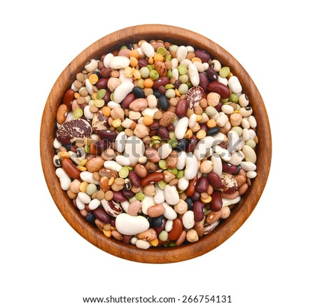 A mixture of legumes in wood bowl, white background. - stock photo