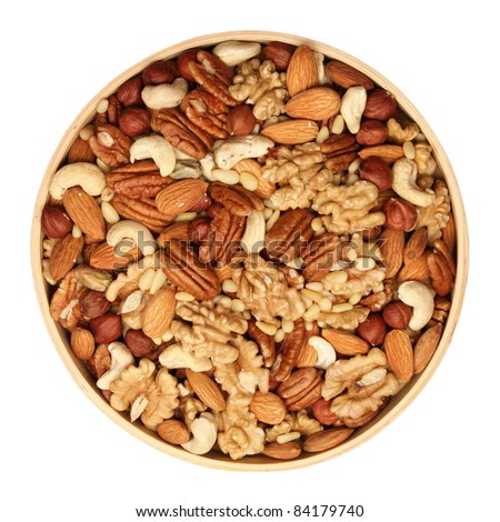 A mixture of nuts in a wooden bowl - pecans, hazelnuts, walnuts, cashews, almonds, pine nuts, pistachios, - stock photo