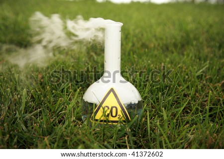 a 500ml beaker filled with CO2  releasing Carbon Dioxide into the atmosphere as A Global Warming Time Bomb - stock photo