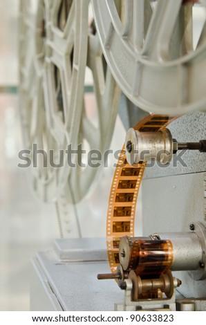 a 16mm cinema projector closeup - stock photo