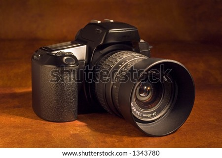 A 35mm SLR camera with standard zoom lens - stock photo