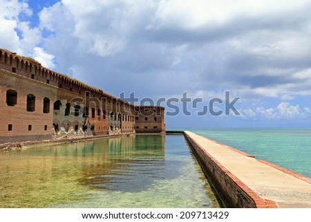 A moat surrounds historic Fort Jefferson in Dry Tortugas National Park, Florida. - stock photo