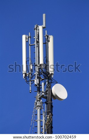 A mobile phone communication repeater antenna - stock photo
