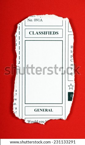 A mock up of a classified advertising newspaper clipping with copy space for your text on a red background - stock photo
