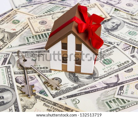 A model home, gift, dollars - stock photo