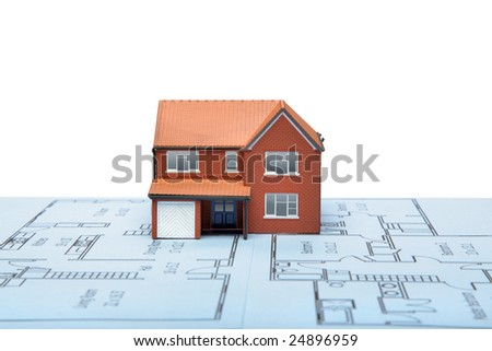 A model house on blueprints with white background - stock photo