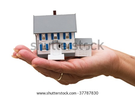 A model house sitting in hands on a white background, mortgage help - stock photo