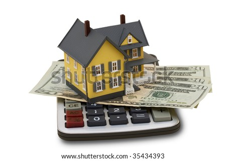 A model house sitting with a calculator and twenty dollar bills on a white background with clipping path, mortgage calculator