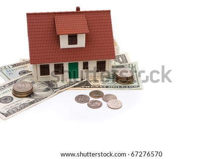 A model house with money isolated on a white background, mortgage payment - stock photo