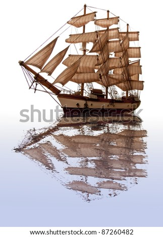 A model of an old clipper on a white background with a reflection in water. Clipper reflection. - stock photo