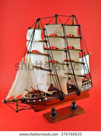A model of  sailboat in red background