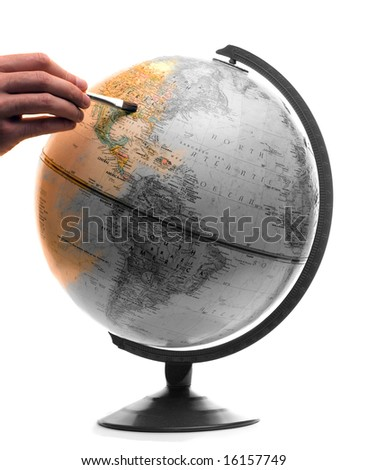 A model of the globe being painted in color, isolated on a white background - stock photo