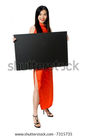 A model posing in the studio in a traditional dress holding a signboard with space for copy