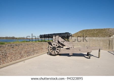 A Model 1846 32 Pound Cannon on the rampart of Fort James Jackson in Savannah Georgia. - stock photo