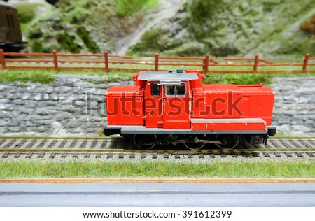 A model railroad steam locomotive in red, selective focus (slightly cold tone) - stock photo