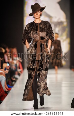 A model walks on the IGOR GULYAEV catwalk. FALL 2015. MERCEDES-BENZ FASHION WEEK RUSSIA. 31 March 2015, Moscow, Russia. - stock photo