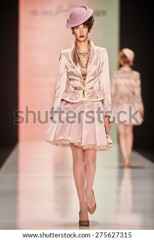 A model walks on theSLAVA ZAITSEV catwalk. FALL 2015. MERCEDES-BENZ FASHION WEEK RUSSIA. 27 March 2015, Moscow, Russia. - stock photo