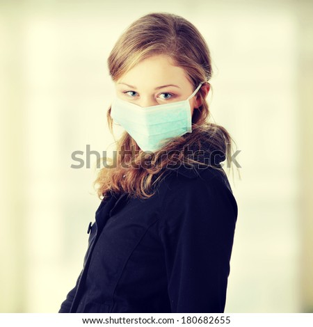A model wearing a mask to prevent 'Swine Flu' infection.  - stock photo