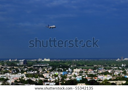 A modern Asian city very densely populated and close to airport - stock photo