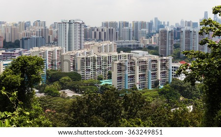 a modern buildings surrounded by jungle, Singapore.