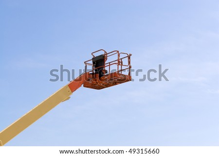 A modern cherry picker or lift for use in commercial construction or painting. - stock photo