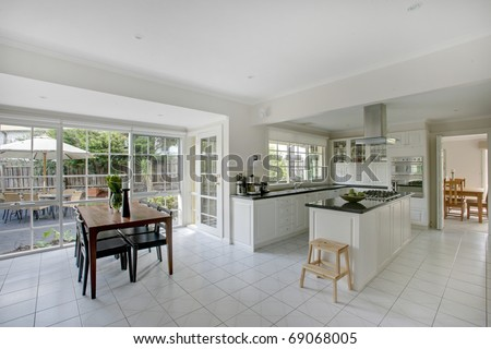 A modern combined kitchen and dining room. - stock photo