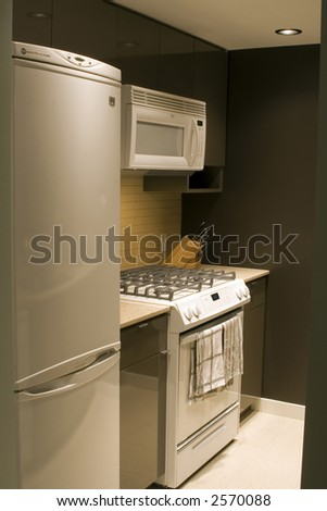 A modern condo kitchen - stock photo