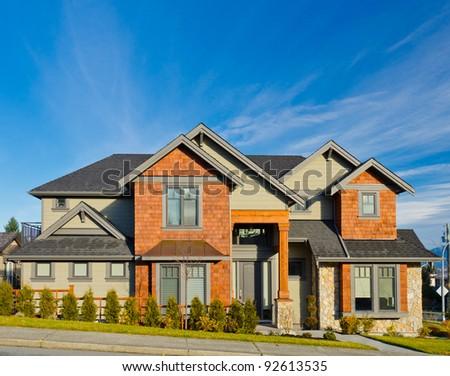 A modern custom built luxury house in a residential neighborhood. - stock photo