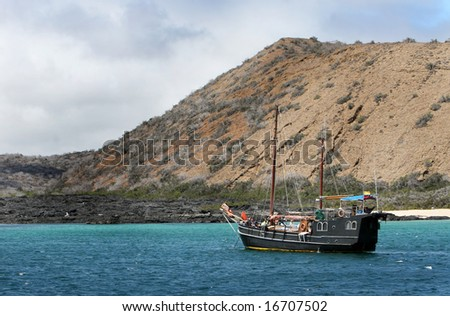 A modern day pirate ship cruises the Galapagos Islands - stock photo