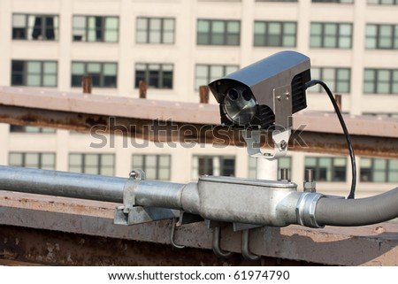 A modern day traffic cam used for surveillance by governmental law enforcement authorities. - stock photo
