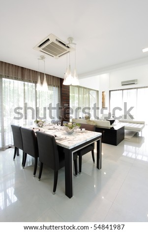 A modern dining table set - stock photo