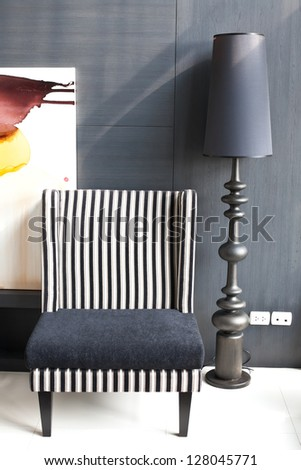 A modern gray sofa and a retro lamp