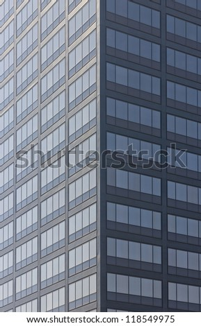 A modern high riser building that may be also used an asymmetrical picture by cropping either side. - stock photo