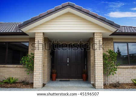 A modern house entranceway and front door - stock photo