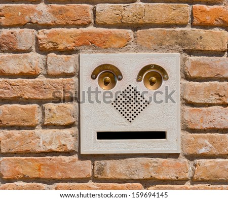 A modern intercom doorbell  panel on old brick wall residential building in Venice, Italy - stock photo