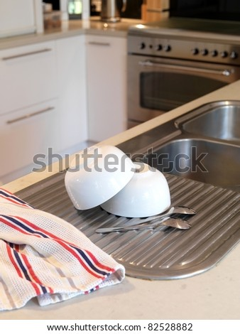 A modern kitchen being used for food preparation - stock photo