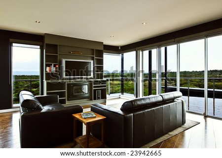 A modern luxury home interior living area with a beautiful view. - stock photo