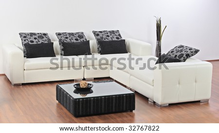 A modern minimalist living-room with furniture - stock photo