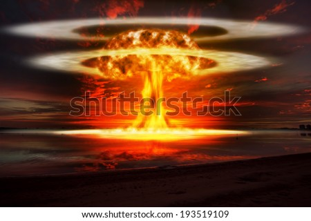 A modern nuclear bomb explosion over water  - stock photo