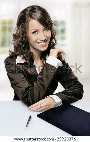 a modern portrait of a young professional businesswoman with pen, window in the background - stock photo