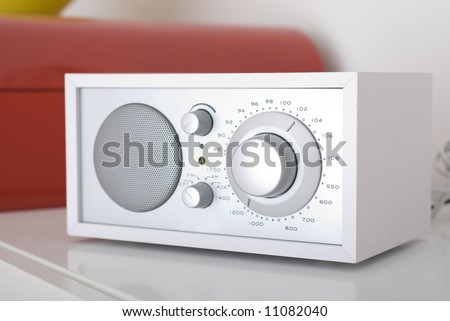 A modern radio set with retro design, white and silver metal
