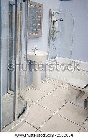 A modern spacious bathroom suite - stock photo